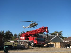 Helicopter flying above the crane