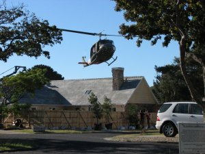 Helicopter hovering above house
