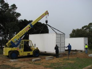 Moving a container into position
