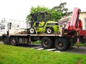 The crane truck arrives