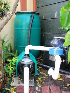 Poolside tank to save backwash