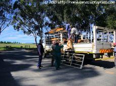 Unloading the school desks from the truck