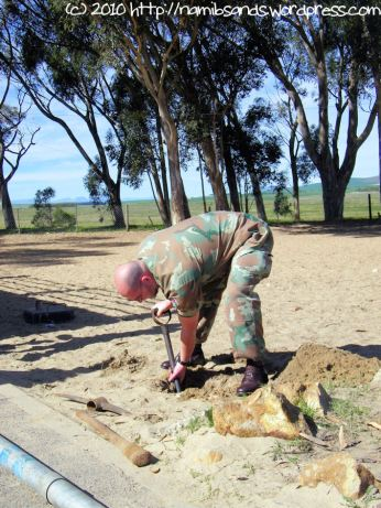 Lt Col Conradie gets down to the business of digging a hole for the new flagpole