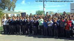 The school proudly sings the national anthem
