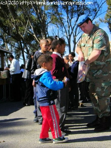 Lance Corporal Leon Wessels handing out the fruit lollies