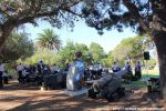 The members of the SA Navy Band are hard at work, setting up their equipment in the shade of some old trees