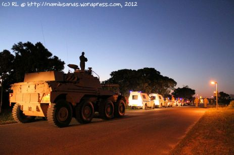The convoy of military vehicles assembles at Fort iKapa in the pre-dawn darkness before sunrise.