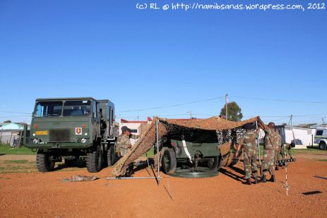The CFA soldiers drape camouflage netting over their 25-pounder gun, which stands alongside their SAMIL 20 gun tractor