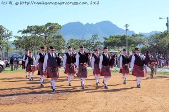 The Cape Field Artillery Pipes and Drums are led onto the field by Pipe Major Staff Sergeant Andrew Imrie