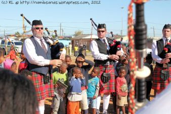 Can you see the kid with his fingers in his ears? He obviously wasn't used to the wailing bagpipes!