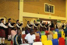 The imbizo begins in festive mood with a performance from the CFA Pipes and Drums inside the hall