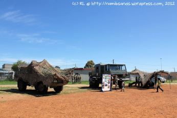 The Mamba on the left is concealed by the camo-netting, and on the right is the Cape Field Artillery display