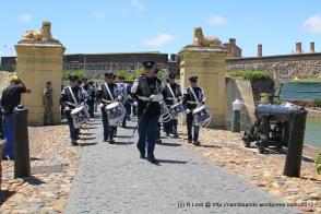 The Het Historisch Tamboerkorps van der Koninklijke Marechaussee from the Netherlands march through the Lions Gate