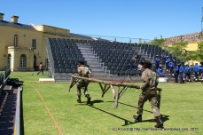 The wranglers run to remove the obstacles from the arena