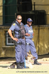 Police and sniffer dogs check the premises