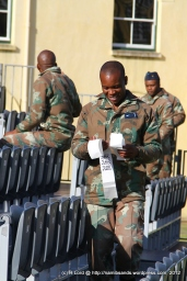 Troops from the SA Air Force applying stickers to all the seats