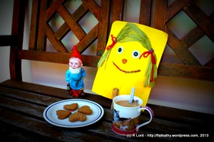Flat Kathy shares a plate of cookies with Gilbert the Gnome