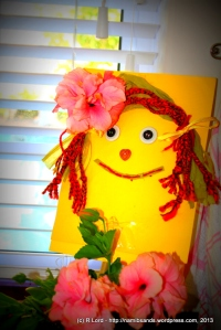 Flat Kathy looks stunning after her makeover - and the pink hibiscus flowers really suit her