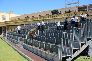 The SA Navy Ushers are busy affixing numbers to all the seats