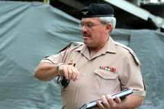 MWO Karel Minnie, the RSM of Regiment Oranjerivier, checks his watch - he is time-keeper