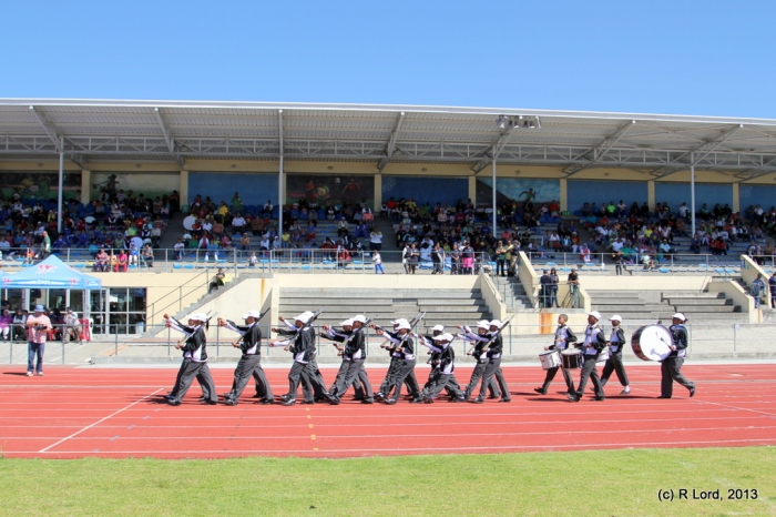 One of the final squads marching past the grandstand