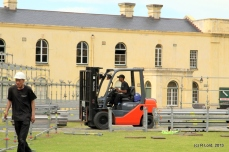 Forklift man drives up and down, bringing in all the bits and pieces