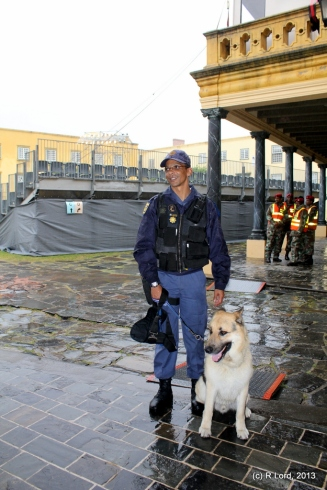 A friendly K-9 police officer with his sniffer dog Bolt obligingly poses for a picture