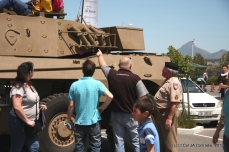 Master Warrant Officer Karel Minnie of the Regiment Oranjerivier explained some of the features of the powerful Rooikat armoured vehicle to a group of curious visitors.