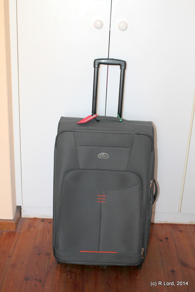 What we're looking for is the slightly smaller brother of this Paklite suitcase - it also has an orange lock and, I think, probably a colourful ribbon or something wrapped around the handle, as that's what we usually do to help us identify our suitcase quickly on the caroussel.