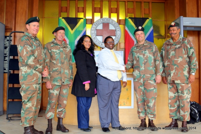The Cape Town Rifles (Dukes) presented a large donation of toys and educational games to the Friends of the Children's Hospital Association at the Red Cross War Memorial Children's Hospital on 18 June 2014 to celebrate Youth Day. (left to right) Capt John Dorrington, WO2 Mike Cairns, Janine Heuvel, David Stephens, Lt Col Francois Marais, and RSM Daantjie Prins.