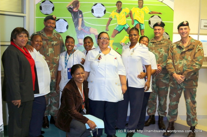 In Ward D1, we meet some of the dedicated and friendly nursing staff, who obligingly pose for a photo with Lt Col Francois Marais, Capt John Manning and RSM Daantjie Prins