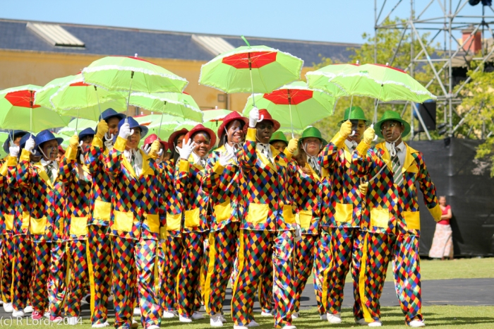 The Cape Town Entertainers in their colourful minstrel costumes, twirling umbrellas and glittering hats