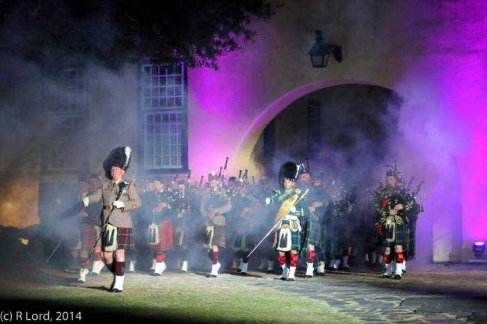 Out of the swirling mists emerge the Massed Pipes and Drums, led by Drum Major WO1 Johan le Roux