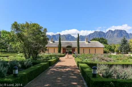 The path leading straight towards Stables restaurant through the small octagonal herb and veggie garden