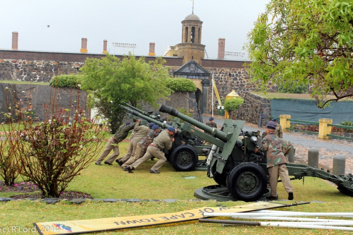 The members of Cape Field Artillery's Saluting Troop align the 25-pounder guns in front of the Castle in preparation for the 1812 Overture