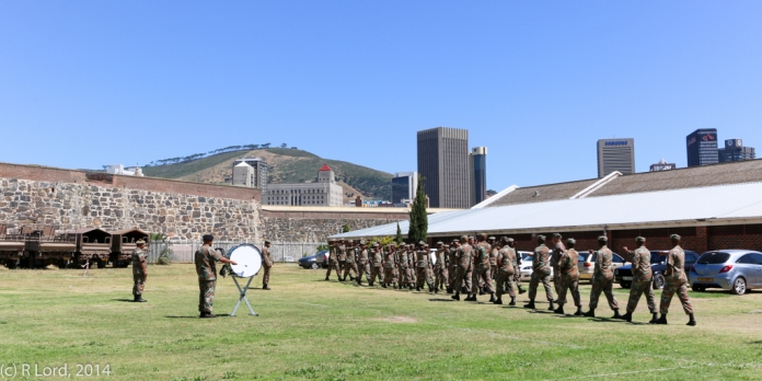 WO2 Jerome Mecloen of the SA Army Band Western Cape uses the drum to issue instructions to the troops