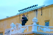The lone piper - traditionally right ontop of the Kat parapet - tries out his new spot ontop of the Kat balcony