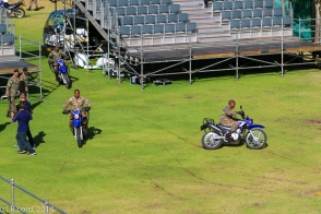The bikers rehearse their slide and drop...