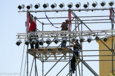 The men from 3 Electrical Workshop are securing the lights