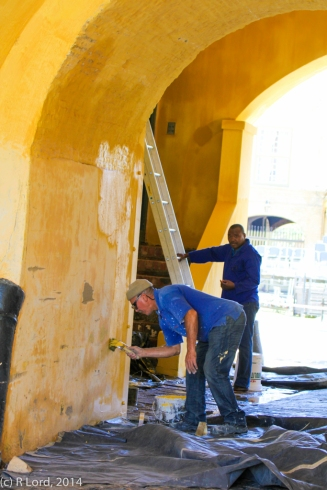 The painters are busy in the archway - I like the cheerful colour!