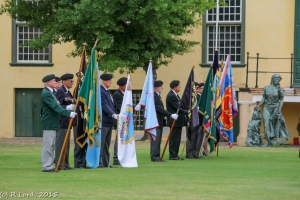 The MOTHS standard bearers line up on the far side of the arena