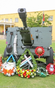 Wreaths are laid all around the 25-pounder gun of the Cape Field Artillery Saluting Troop