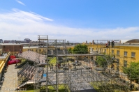 We climb up to the roof for an almost-bird's eye view - the giant rig of scaffolding seems to be higher than the roof now