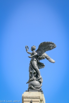 The statue of winged victory at the top of the central column