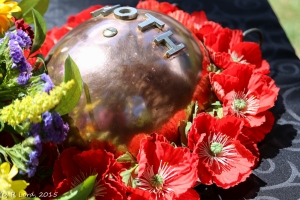 The MOTHs wreath consists of a tin hat surrounded by red poppies
