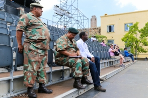 Lt Col Tienie Lott (Poducer), Lt Col Ralph Wilkinson (Executive Officer) and Capt (SAN) Marcus Rammutloa (Media Liaison Officer) watch from the stands
