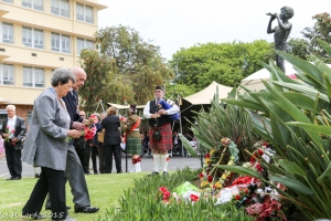 Pipe Major Andrew Imrie playing the lament as the wreaths are being laid